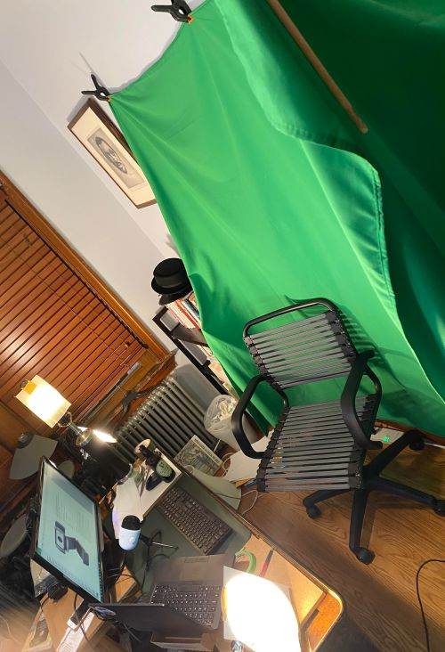 a picture of my makeshift home office with green screen.